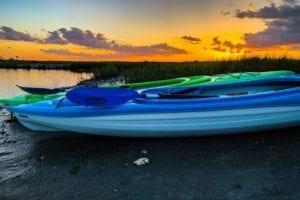 two kayaks stopped on the banks of the cherry grove salt marsh