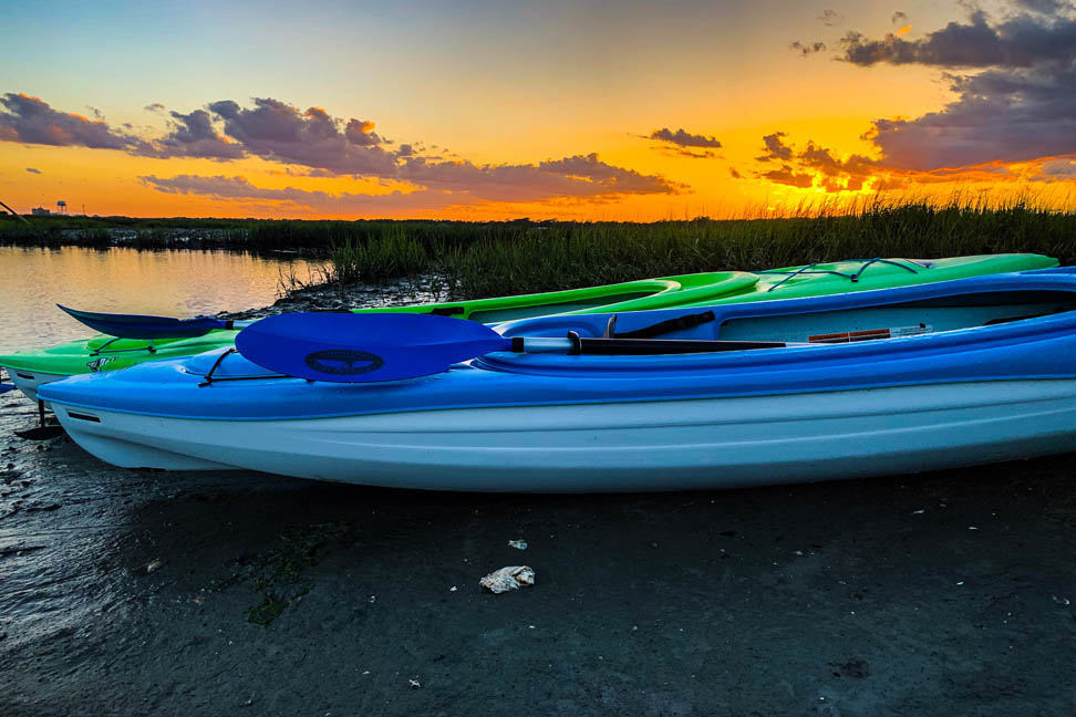 two kayaks stopped on the banks of the cherry grove salt marsh north myrtle beach